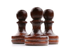 Trois seules pièces d'échecs en bois noires d'isolement sur le blanc images stock