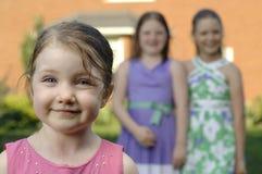 Trois soeurs dans le jardin Image libre de droits