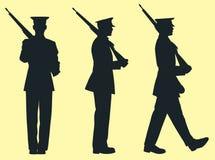 Trois soldats de silhouette Images stock