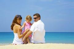 Trois sur la plage Photos libres de droits