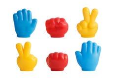 Trois taille-crayons multicolores sous forme de mains image libre de droits