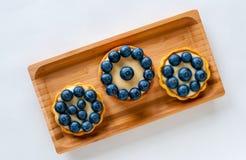 Trois tartes avec des myrtilles Photographie stock