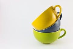 Trois tasses de couleur de café Images stock