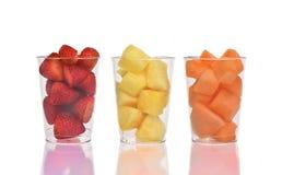 Trois tasses de fruit Photographie stock