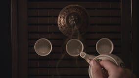 Trois tasses de th? chinois banque de vidéos