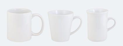 Trois tasses opaques de bureau d'isolement sur le blanc Images stock