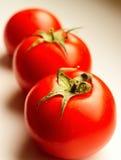 Trois tomates Photographie stock