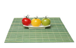 Trois tomates organiques colorées Images stock