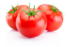 Trois tomates rouges d'isolement sur le fond blanc Photo libre de droits