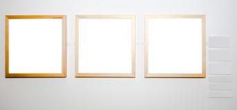 Trois trames vides sur le mur blanc Photographie stock