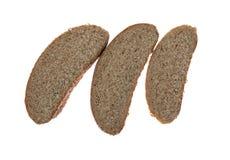 Trois tranches de pain foncé Photos libres de droits