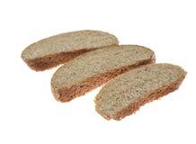 Trois tranches de pain foncé Images libres de droits