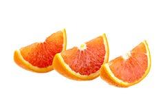Trois tranches oranges d'isolement sur le blanc Images stock