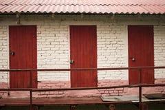 Trois trappes rouges Photographie stock libre de droits