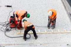 Trois travailleurs de route images stock