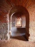 Trois trous arqués de porte dans un mur de briques Photos libres de droits