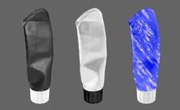 Trois tubes écrasés Photographie stock libre de droits
