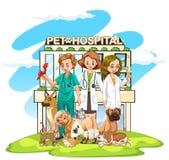 Trois vétérinaires et beaucoup d'animaux familiers à l'hôpital Images stock