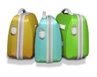 Trois valises colorées Photos libres de droits