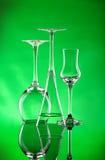 Trois verres à vin avec un feu vert Photos stock