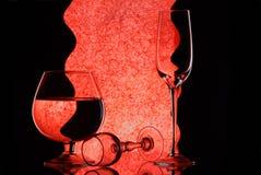 Trois verres à vin sur le miroir Photographie stock