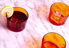 Trois verres oranges photographie stock libre de droits