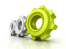 Trois vitesses de roue dentée avec le chef vert sur le fond blanc Image stock