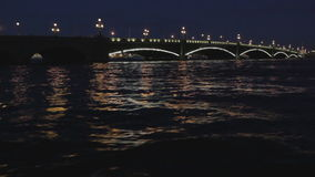 The Troitsky bridge in Saint Petersburg. The Troitskiy Bridge in Saint Petersburg at night. Sail across the Neva river. Shot on Canon 5D Mark II with Prime L stock video footage