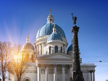 Troitsky Izmaylovsky cathedral, 18th century, and a monument `A column of Military glory`, in memory of the Russian-Turkish war. In St. Petersburg, Russia royalty free stock photography