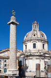 Trojan column and churches of Santa Maria di Loreto in Rome Royalty Free Stock Photography