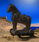 Trojan Horse in front of the Walls of Troy. 3D render of Homer's Trojan Horse in front of the Walls of Troy and the Aegean Sea Royalty Free Stock Photo