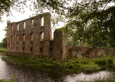 Trojborg castle ruin near Tonder, Denmark. Showing a brick wall with windows and the castle moat stock photos