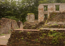 Trojborg castle ruin near Tonder, Denmark. Showing a brick wall with windows and parts of walls and the courtyard stock photography