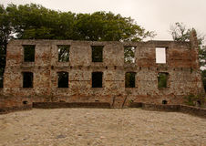Trojborg castle ruin near Tonder, Denmark. Showing a wall made of bricks with windows and the castle coartyard stock photo