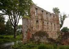 Trojborg castle ruin near Tonder, Denmark. Showing a wall made of bricks with windows and the castle moat royalty free stock photography