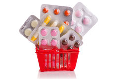 Trole da compra com comprimidos e medicina isolada no branco Imagens de Stock