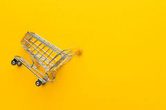 Trole da compra no fundo amarelo Imagem de Stock Royalty Free