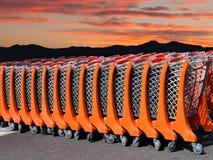 Troles da compra do supermercado no por do sol Fotografia de Stock Royalty Free