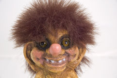 Troll. Smiling troll doll on the white background. Typical souvenir from Scandinavian countries Stock Image