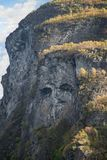 Troll Face on a Cliff of the Geirangerfjord. More og Romsdal, Norway Stock Photo