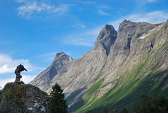 Troll and mountain against the sky. Trollstigen. Royalty Free Stock Photography