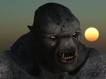 Troll portrait. Close up image of monstrous grey skinned troll with glowing eyes and bared fangs Stock Images