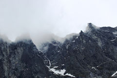 The Troll Wall in Norway. Magestic summer foggy mountains Stock Photos