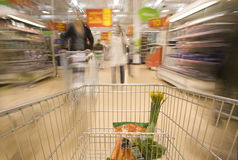 Trolley. Moving in supermarket, motion blur Royalty Free Stock Images