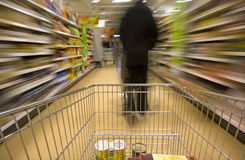 Trolley. Moving in supermarket, motion blur Stock Images