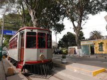 Trolley belonging to the Musuem of Electricity in Barranco district of Lima. Lima, Peru. October 1, 2016. Antique gray and red  trolley belonging to the Museum Royalty Free Stock Photo