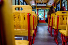 Trolley bench wood seat. Wood bench seats on city trolley Royalty Free Stock Photography