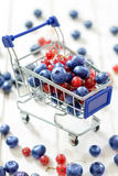 Trolley with berry Royalty Free Stock Image