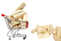 Trolley and Blocks. Shopping trolley with wooden blocks Royalty Free Stock Photography