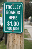 Trolley Boards Here Sign. $1.00 Per Ride Royalty Free Stock Photography